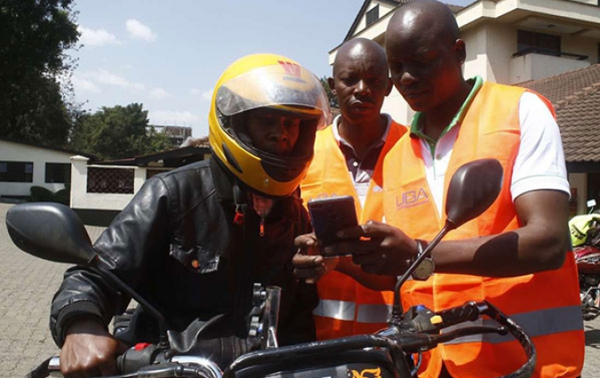A boda-boda rider in Kenya's Nakuru County on July 17, 2018 during the launch of a digital platform Bodacare. Ensuring that low-income earners access information can have huge development benefits. PHOTO | AYUB MUIYURO | NMG