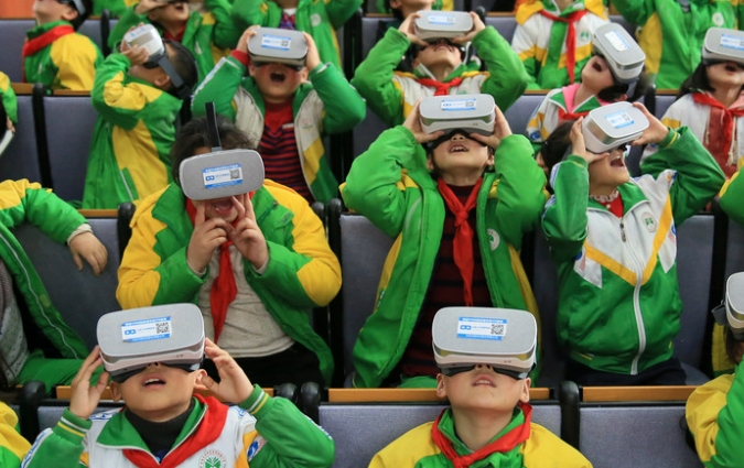 Primary school students in China wear virtual reality headsets